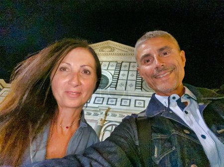 Photo for Happy couple taking selfie at night in Florence. - Royalty Free Image