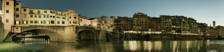 Photo for Old Bridge and Florence Lungarni at night. Panoramic cityscape of Firenze in Autumn, Tuscany - Italy - Royalty Free Image