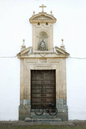 The bicycle in front of old door. Cordoba, Spain.