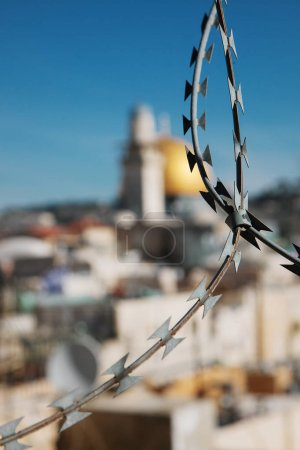 Jerusalem's Dome of the Rock seen through barbed wire