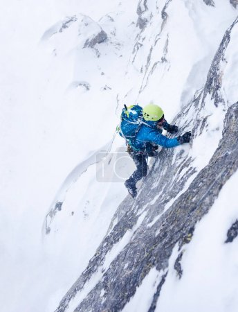 Girl during an extreme winter climb