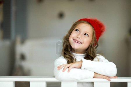 Portrait of smiling little girl. Beautiful little girl celebrates Christmas.