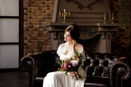 Bride in wedding dress. Bride in a luxury apartment in a wedding dress.