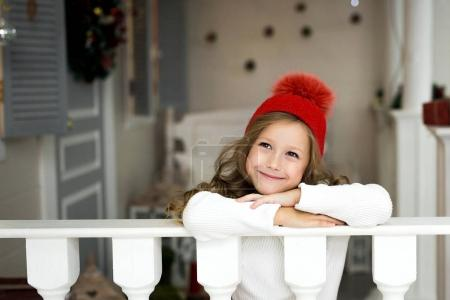 Portrait of a beautiful smiling little girl in the studio. New Years holidays.