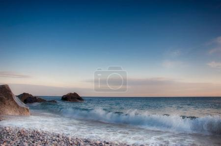 Calm seascape with rocky coast