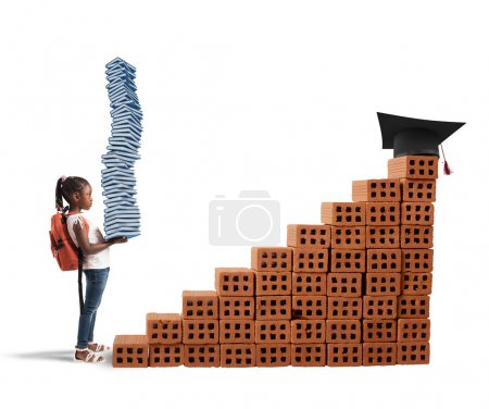 Photo for Child with backpack and study books climbs a bricks scale - Royalty Free Image