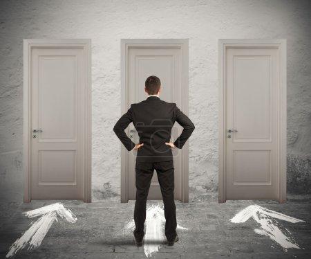 Businessman uncertain which door choose