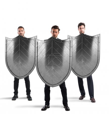 Businessmen with shields. concept of protection