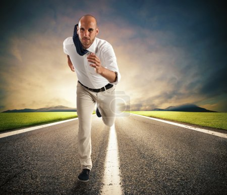 Businessman running on road