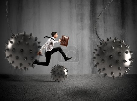 Photo for Businessman between fierce spiky balls that hinder - Royalty Free Image