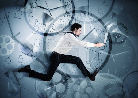 Photo for Overworked and late businessman running with the laptop - Royalty Free Image