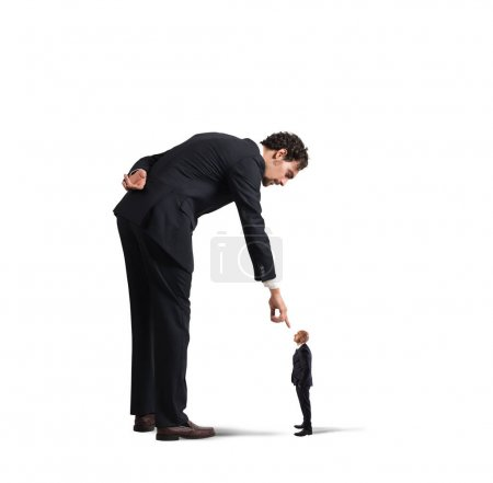 businessman  pointing a small man