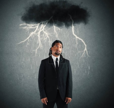 businessman with cloud over his head