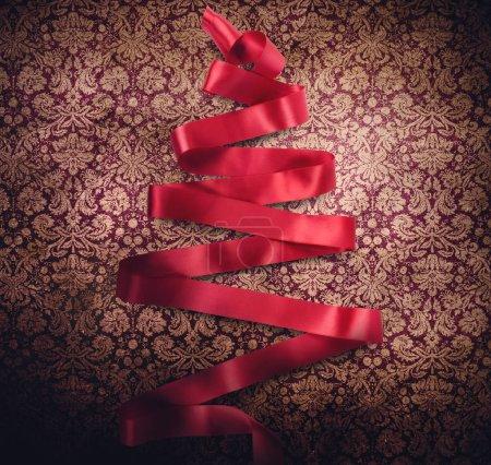 Red xmas tree of ribbon