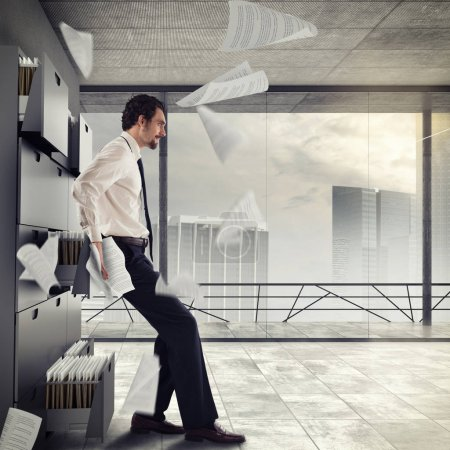 businessman pushes drawers