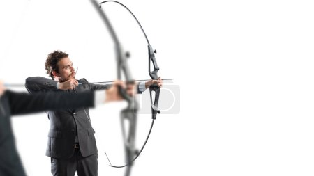 Photo for Businessman in a competition with the arc and arrow to reach and hit new targets - Royalty Free Image