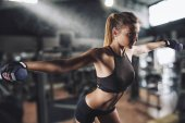 Muscular woman is training