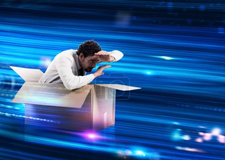 Man in a cardboard box on wires optical fibers wit...