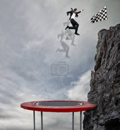 Businessman jumping on a trampoline