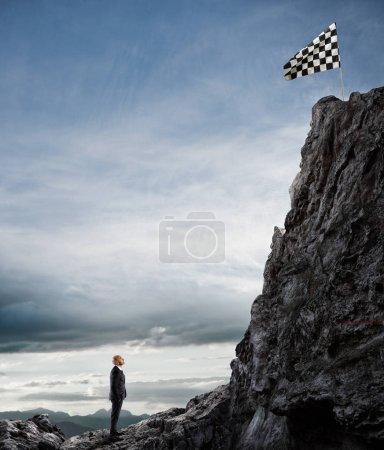 Businessman looks at a flag