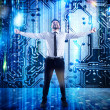 Businessman rejoices with futuristic background of...