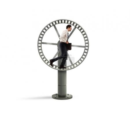 Businessman running on the hamster wheel.