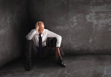 Photo for Alone desperate businessman sitting  on the floor. solitude and failure concept - Royalty Free Image