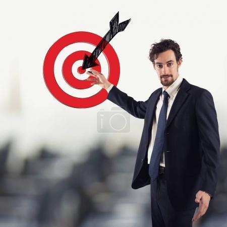 Businessman drawing a target