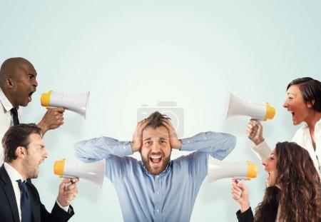 Photo for Stress concept with colleagues who screams to businessman - Royalty Free Image