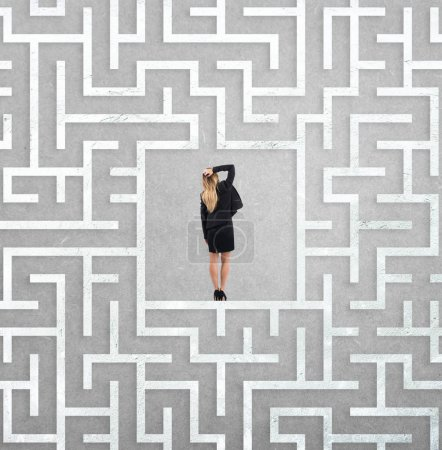 businesswoman at the center of a big maze