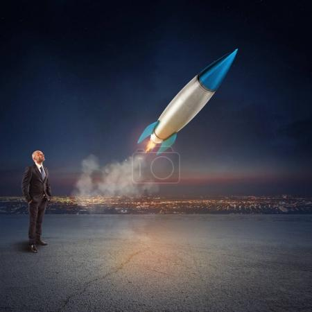Businessman looking at  start of  missile