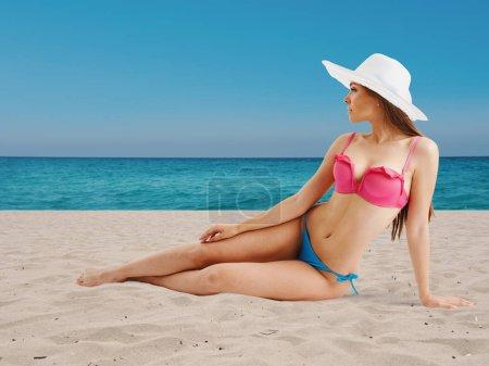 Photo for Girl in bikini sunbathing on a tropic beach - Royalty Free Image