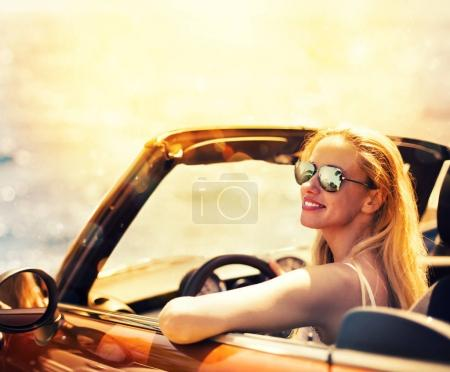 Young woman in cabriolet car