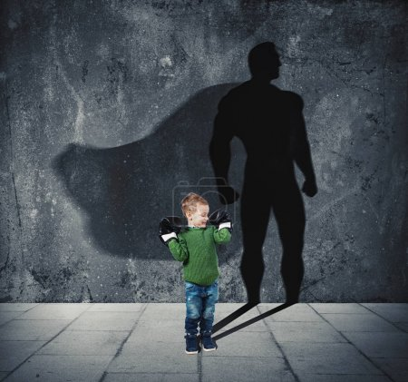 Young child with his shadow