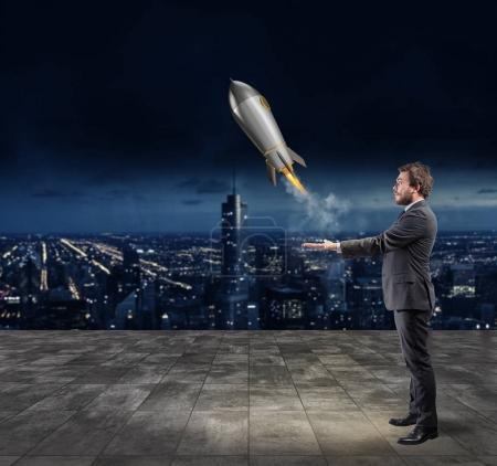 Businessman throwing  a rocket