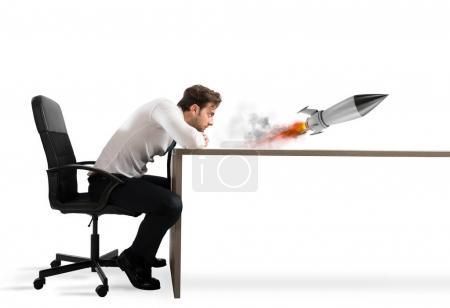 businessman with starting rocket.