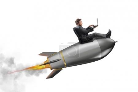 Businessman on  a small rocket.