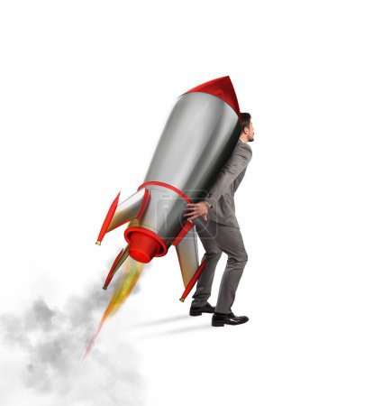Businessman holding a missile