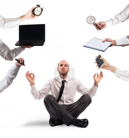 Relaxed businessman that does yoga
