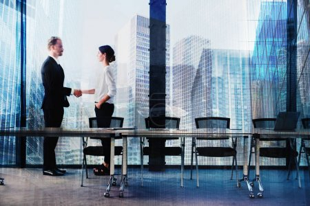 Photo for Handshake of two businesspeople  in a modern office. concept of partnership and teamwork - Royalty Free Image