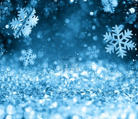 Abstract glowing Christmas blue background