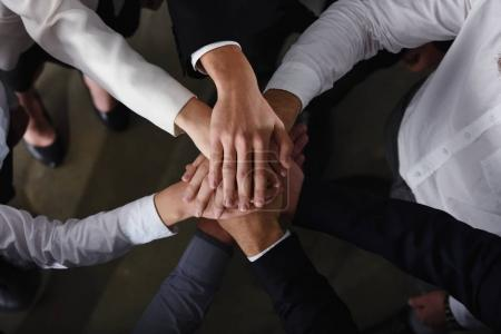 Photo for Business people joining hands in a circle in the office. concept of teamwork and partnership - Royalty Free Image