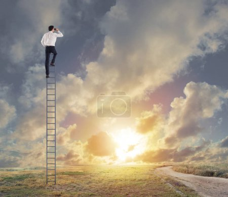 Businessman on a stairs looking  far