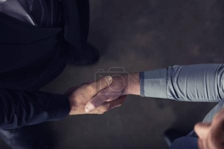 Handshaking business people