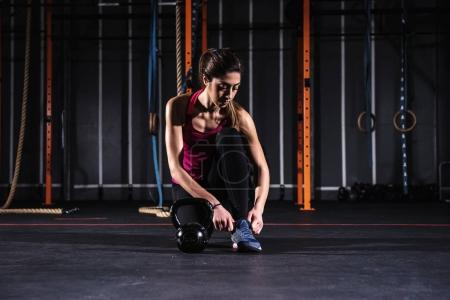 athletic girl working  out at the gym