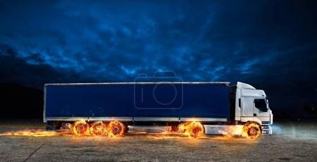 Super fast delivery of package service. A truck with wheels on fire on the road