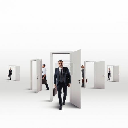 Businessmen choosing  the right door