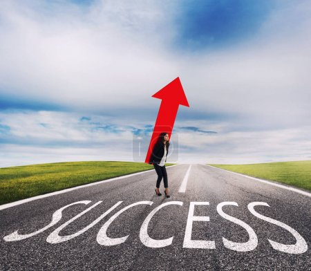 Businesswoman holds a big arrow on a success way. Concept of successful businesswoman and company startup