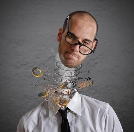 Stress and overwork concept. Explosion of a head of a businessman