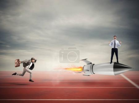 Winner businessman over a fast rocket. Concept of business competition